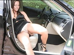 Chick spreads long legs wide open and inserts toy in snatch
