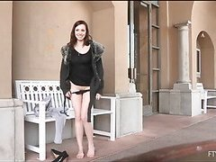 Girlie is spreading long legs wide and pushes dildo in hole