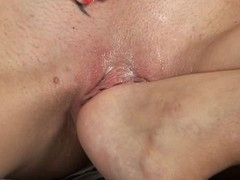 Alluring beauty is pounding her sexy twat with hard sex-toy